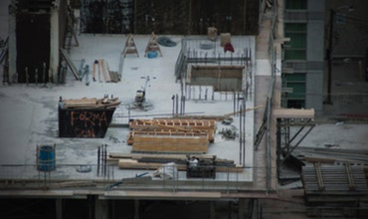the top of a building's roof with construction equipment on it